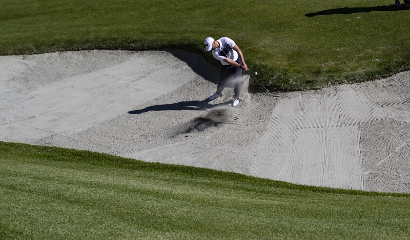 Wyndham Clark hits out of the bunker on the second hole during the second round of the Genesis Invitational at Riviera Country Club.