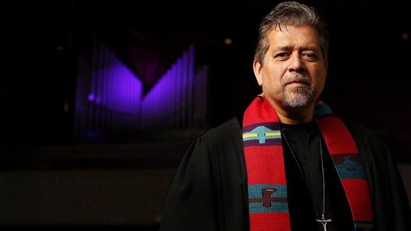 The Rev. Walter Contreras is photographed inside the sanctuary at Pasadena Presbyterian Church in Pasadena on May 23, 2016.