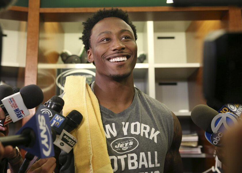 New York Jets wide receiver Brandon Marshall answers a question as he stands in the locker room after NFL football practice Wednesday, June 1, 2016, in Florham Park, N.J. (AP Photo/Mel Evans)