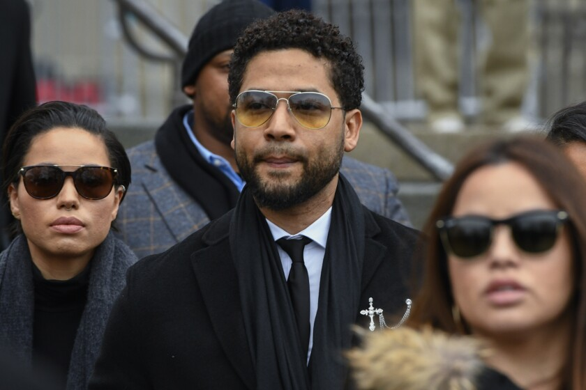 """FILE - In this Feb. 24, 2020 file photo, former """"Empire"""" actor Jussie Smollett leaves the Leighton Criminal Courthouse in Chicago. A judge on Friday, July 30, 2021, announced that he would not kick one of Smollett's attorneys off the case, saying that although he believed the attorney talked to two men the actor allegedly hired to carry out a phony racist and homophobic attack, that such conversations should not disqualify him from the case. (AP Photo/Matt Marton, File)"""