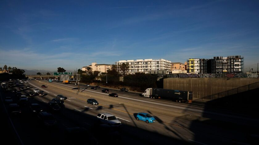 LOS ANGELES, CA - NOVEMBER 21, 2017 -- Traffic flows below a pair of homeless housing developments t