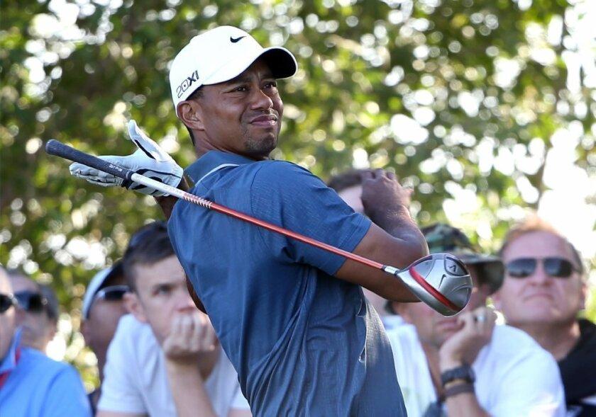 Tiger Woods competes in Abu Dhabi last week.