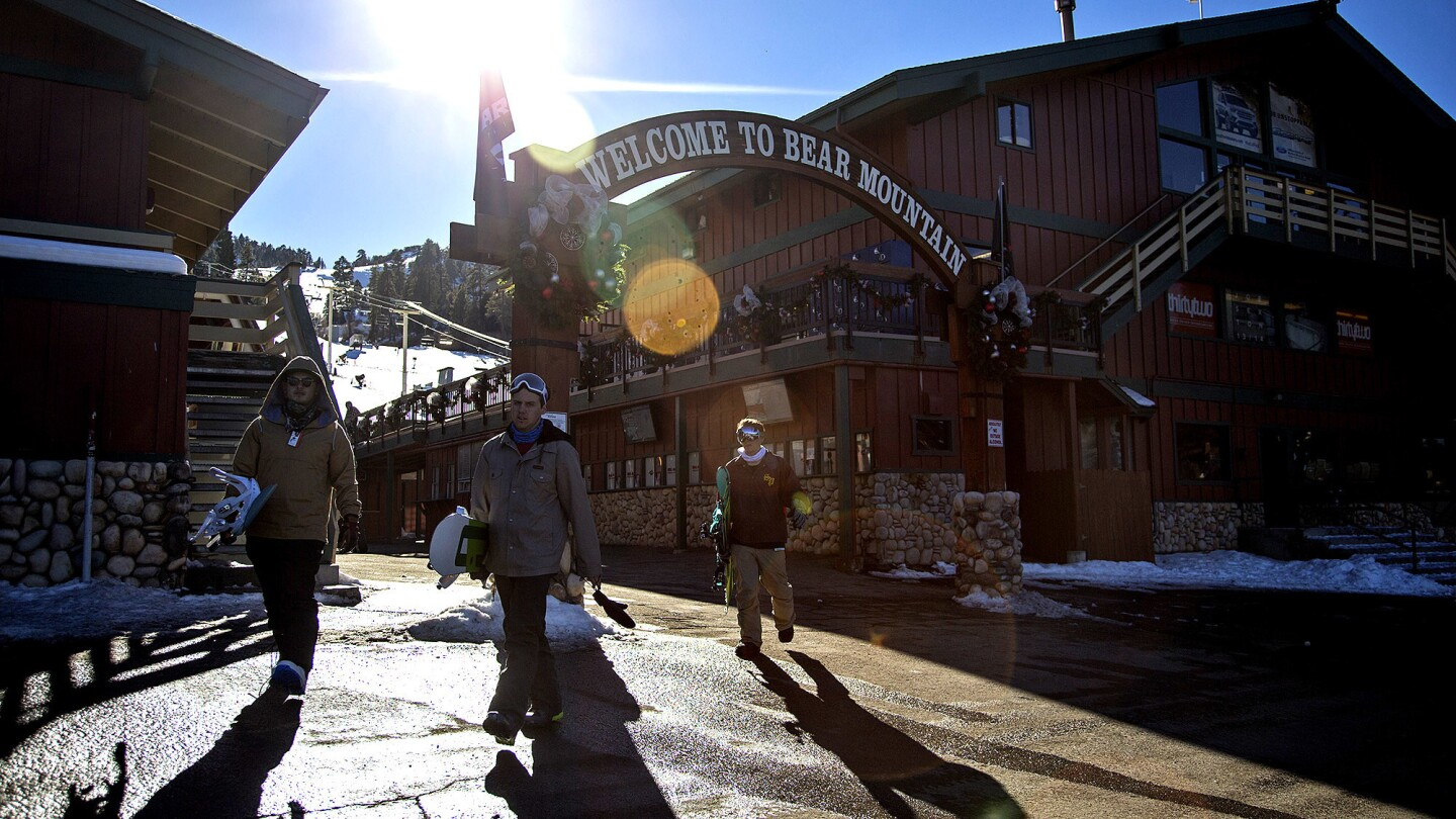 Snowboarders leave Bear Mountain on a sunny 50-degree day in December.