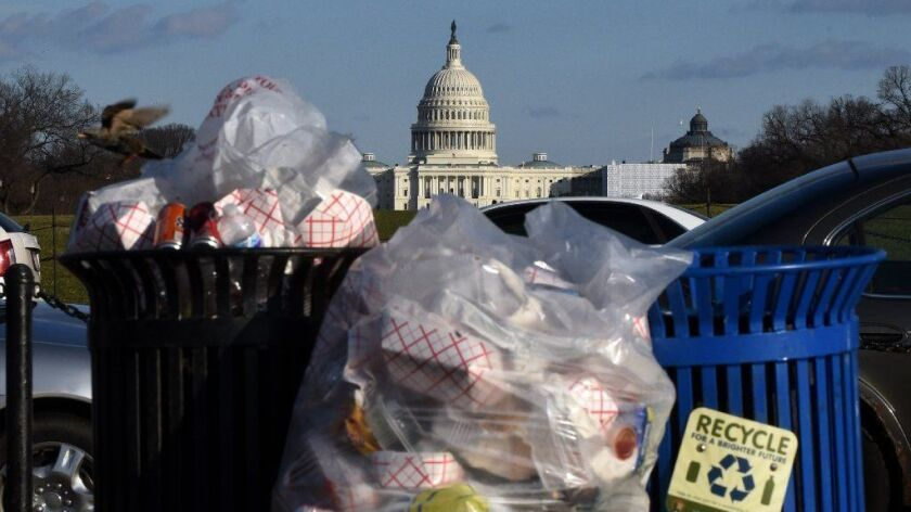 Trash builds up along the National Mall on Dec. 24 as trash collectors are off work during a partial government shutdown.