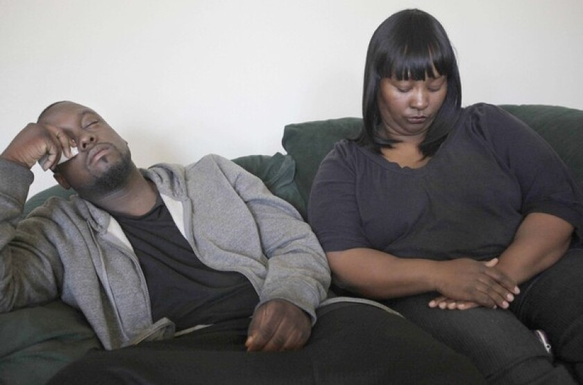 Deandre Franks, 22, the boy's father, and Sharlynn Pinkard, the boy's grandmother, react in the wake of the death of Deandre Green, 2. Franks says he had gone to police with his suspicions of abuse.