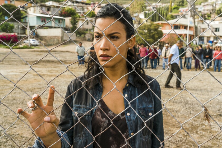 "Luciana (Danay Garcia) stoically watches a man sacrifice himself to zombies on ""Fear the Walking Dead."""