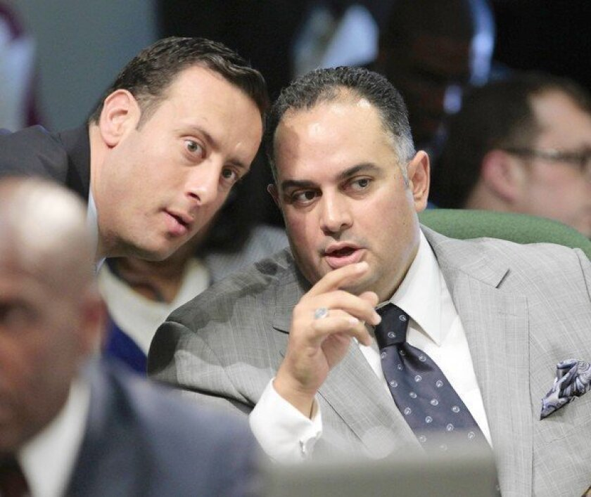 Assembly Speaker John A. Pérez, at right with Assemblyman Roger Hernandez, is pushing legislation that he said would close a corporate tax loophole and raise $1 billion for scholarships for middle-class college students.