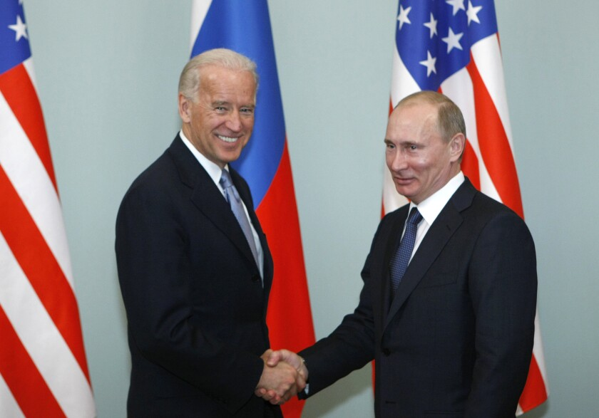 In 2011, then-Vice President Joe Biden shakes hands with Russian Prime Minister Vladimir Putin in Moscow.