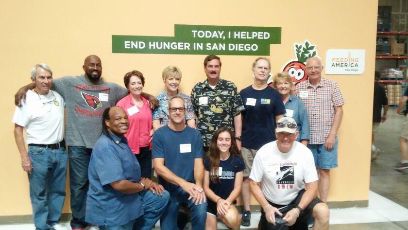 Sunrise Rotary Club of La Jolla members volunteer to sort food with Feeding America.