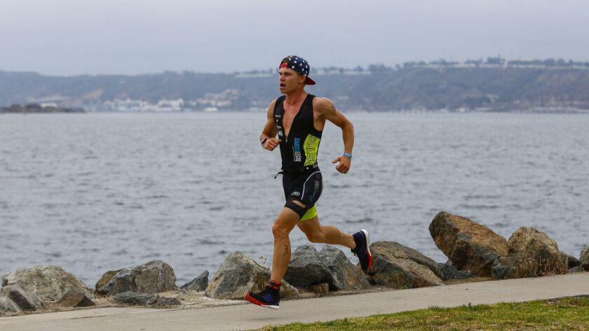 Alexander Romanenko runs around Harbor Island during the running phase of Sunday's triathlon.