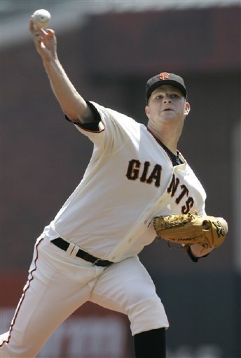 San Francisco Giants' Matt Cain pitches to the Washington Nationals in the first inning of a baseball game in San Francisco, Thursday, July 24, 2008. (AP Photo/Jeff Chiu)