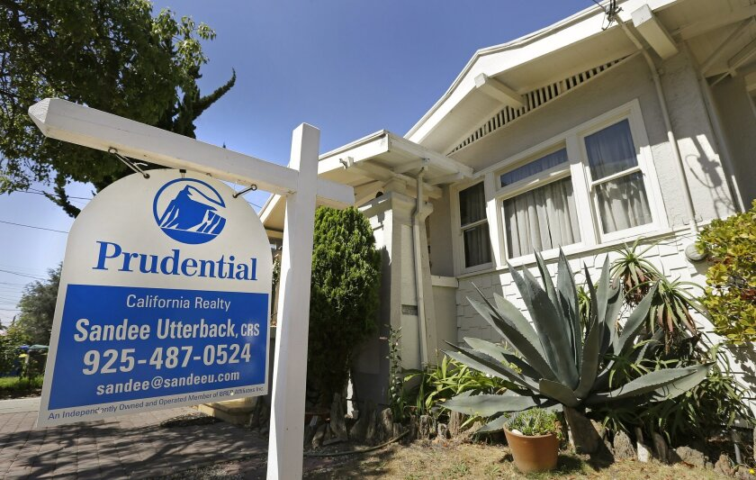 FILE - This Monday, July 14, 2014 file photo shows a home for sale in Alameda, Calif. Freddie Mac reports on average U.S. mortgage rates for this week on Thursday, Aug. 14, 2014. (AP Photo/Ben Margot, File)