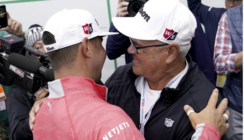 Gary Woodland celebrates after winning the U.S. Open Championship golf tournament with his father Da