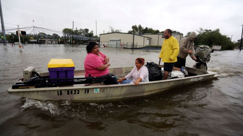A privately owned boat ferries evacuees to safety in rising floodwaters from Tropical Storm Harvey i