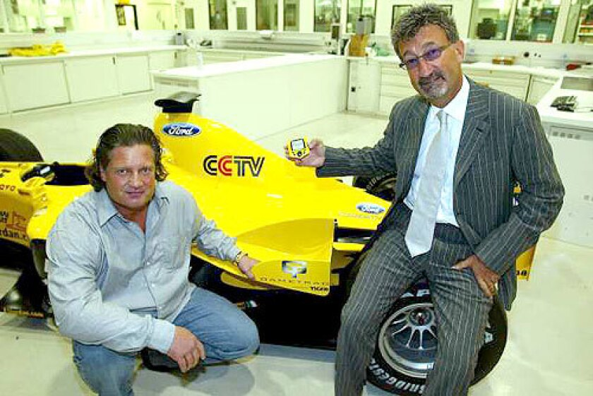THE GOOD LIFE: Bo Stefan Eriksson, on trial after a Feb. 21 crash in Malibu, poses with a racing car at the British Grand Prix in 2003.