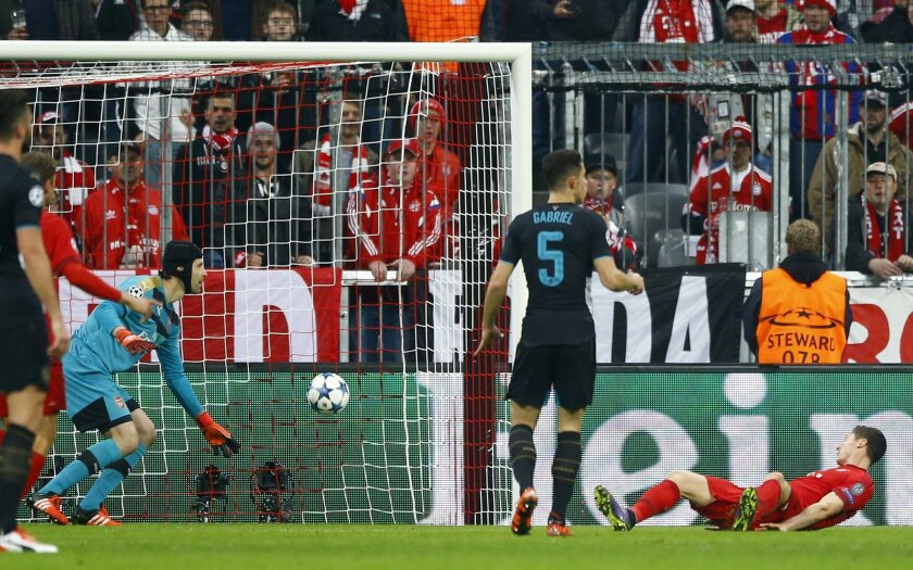 Bayern's Robert Lewandowski, right, scores the opening goal past Arsenal goalkeeper Petr Cech, left, during the Champions League Group F soccer match between Bayern Munich and Arsenal FC in Munich, southern Germany, Wednesday, Nov. 4, 2015. (AP Photo/Matthias Schrader)