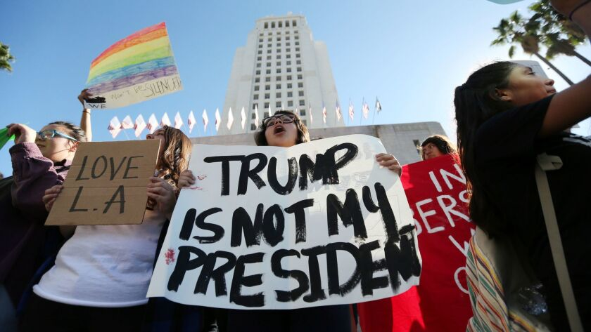 Students from several high schools rally at City Hall in downtown Los Angeles on Nov. 14 after walking out of classes to protest the election of Donald Trump.