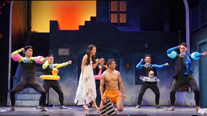 """East West Players' """"Mamma Mia!"""" stars Grace Yoo and Max Torrez, center, surrounded by Steven Agdeppa, left, Kevin Perdido, Andrew Ge, AJ Rafael and Ala Tiatia."""