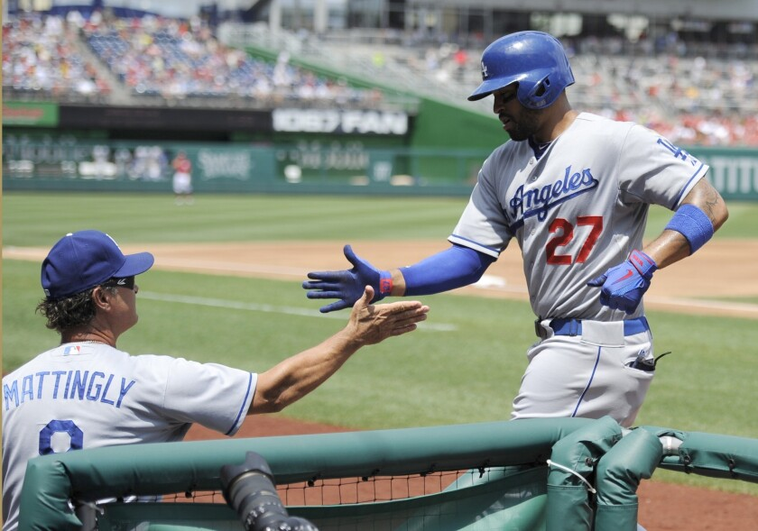 Dodgers Manager Don Mattingly, left, congratulates Matt Kemp on a home run against the Washington Nationals in July. Mattingly is confident Kemp will be back in the lineup this season.