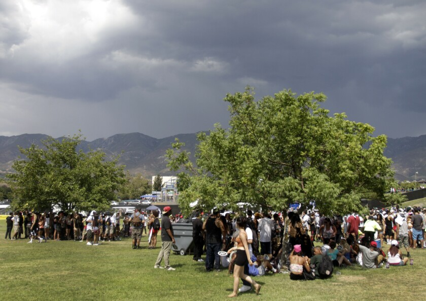 SAN BERNADINO, CA SEP. 07, 2013. The dark cloud drifted over the park gave heat relief to festival goers on day one of Rock The Bells at San Manuel Amphitheatre in San Bernardino on Sep. 7, 2013. Day one of Rock The Bells, a two days festival of hip hop performances. (Lawrence K. Ho/Los Angeles Times)..