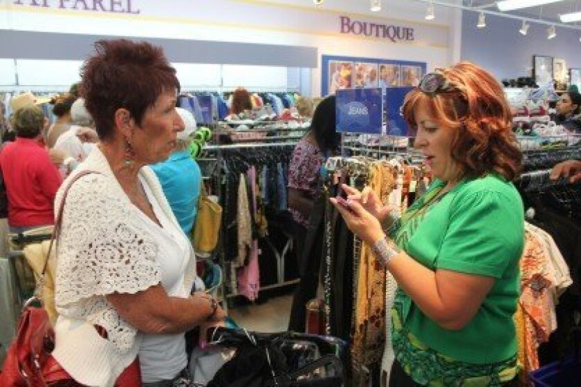 La Mesa resident Marianne Cleveland (left) speaks with Goodwill Industries' San Diego County vice-president of operations, Beth Forsberg