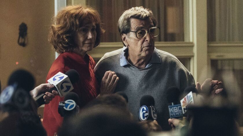 In this image released by HBO, Kathy Baker, left, and Al Pacino portray Sue and Joe Paterno in a sce