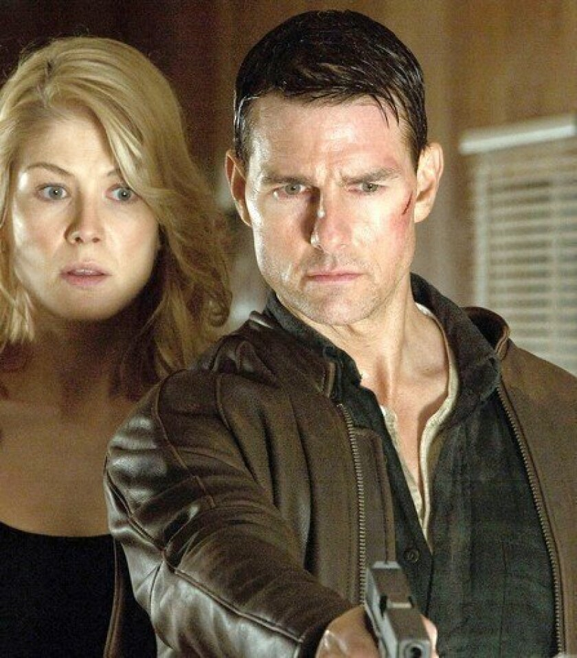 """Rosamund Pike and Tom Cruise in """"Jack Reacher."""""""