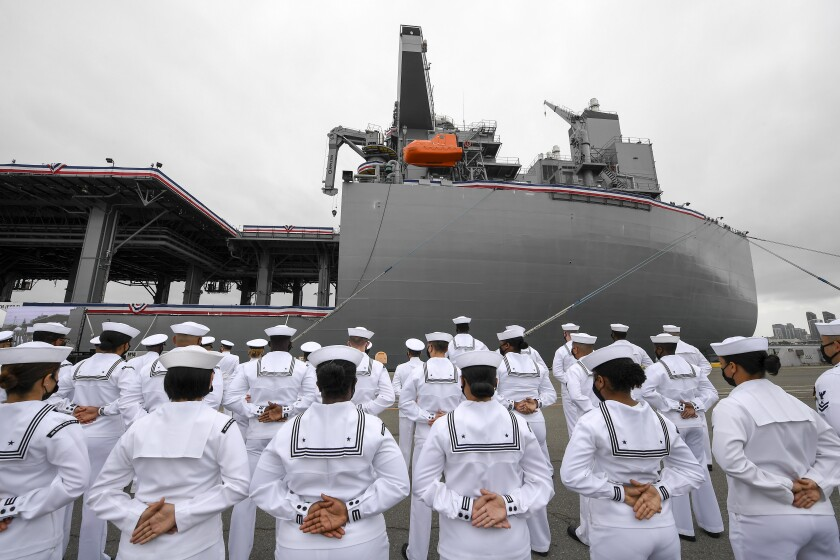 U.S. Navy sailors stand at attention during a commissioning ceremony