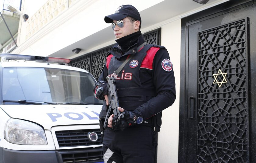 Armed police guards stand in front of Neve Shalom synagogue March 29 in Istanbul, Turkey.