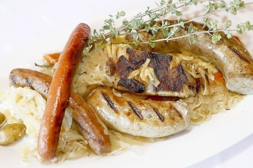 House-made Alsatian-style sauerkraut and sausage plate with house mustard served at The Golden Truffle in Costa Mesa.