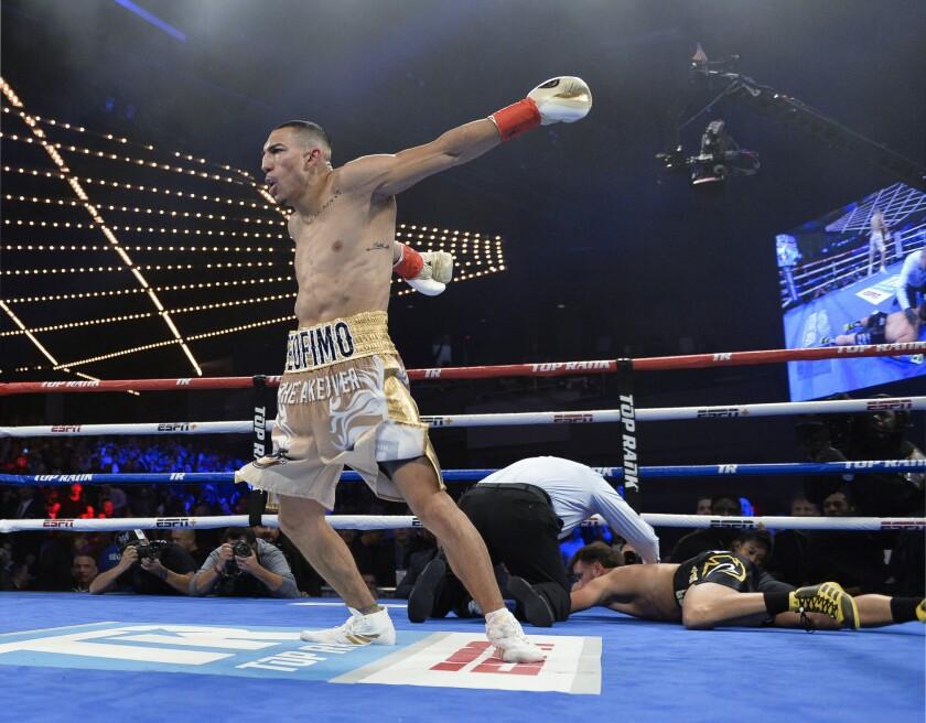 APphoto_APTOPIX Menard Lopez Boxing
