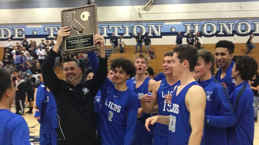 La Jolla Country Day coach Ryan Meier hoists trophy after the Torreys captured the Southern California Regional Division III boys basketball title with a win over Crescenta Valley.