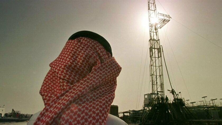 FILE - In this Feb. 26, 1997 file photo, Khaled al-Otaiby, an official of the Saudi oil company Aram