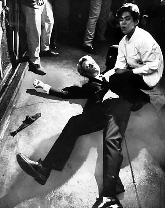 Busboy Juan Romero, 17, comforts Sen. Robert F. Kennedy moments after Kennedy was shot at the Ambassador Hotel on June 5, 1968. See full story