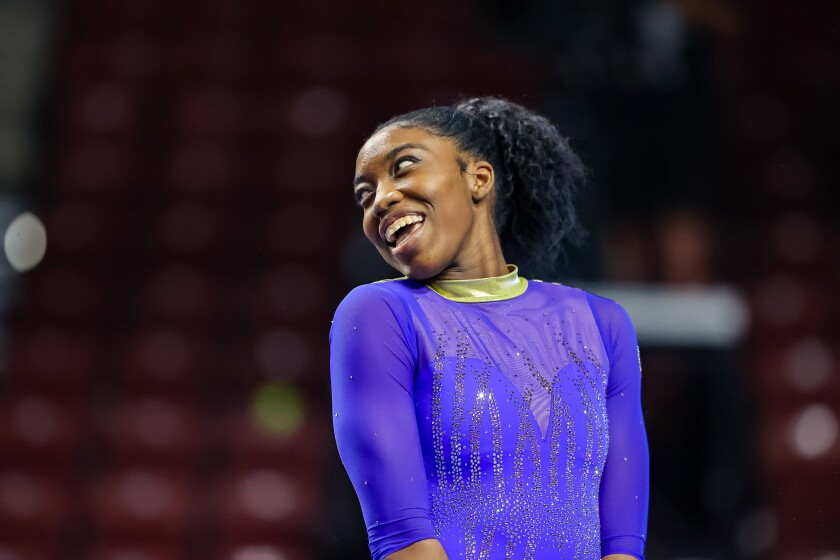 UCLA's Chae Campbell smiles at teammates