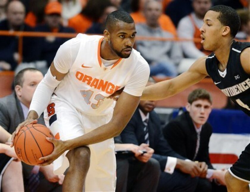 Syracuse's James Southerland, left, looks to pass against Providence's Josh Fortune during the first half in an NCAA college basketball game in Syracuse, N.Y., Wednesday, Feb. 20, 2013. (AP Photo/Kevin Rivoli)