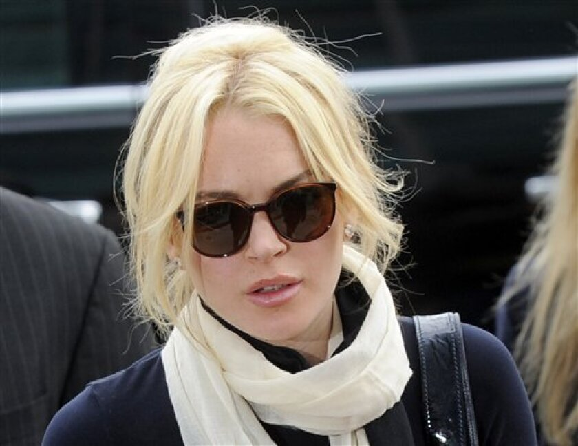 FILE In this April 22, 2011 photo, Lindsay Lohan arrives for a preliminary hearing in Los Angeles. A judge has ordered a man accused of showing up at Lindsay Lohan's court appearances and leaving gifts at her house to stay away from the actress for the next two years. Los Angeles Superior Court Judge Joseph Biderman issued the restraining order against David Cocordan after a hearing Wednesday, June 8 2011, in Santa Monica, Calif. (AP Photo/Chris Pizzello)
