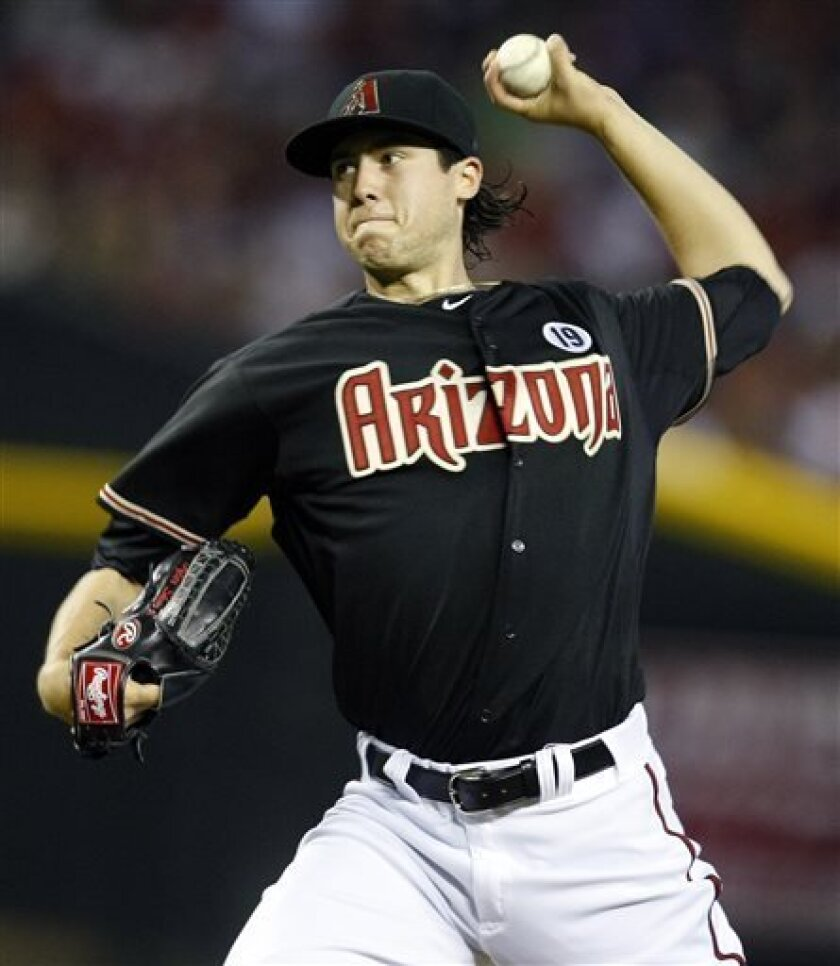 Arizona Diamondbacks pitcher Tyler Skaggs throws in the first inning during a baseball game against the Colorado Rockies on Friday, July 5, 2013, in Phoenix. (AP Photo/Rick Scuteri)