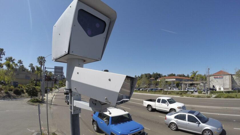 Encinitas has voted to extend for 18 months its contract for red light cameras like these, photographed in 2014 in Vista.