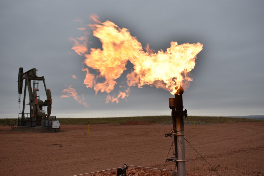 A flare burns natural gas at an oil well Aug. 26, 2021, in Watford City, N.D., part of McKenzie County, the fastest-growing county in the U.S. That's according to new figures from the Census Bureau. (AP Photo/Matthew Brown)