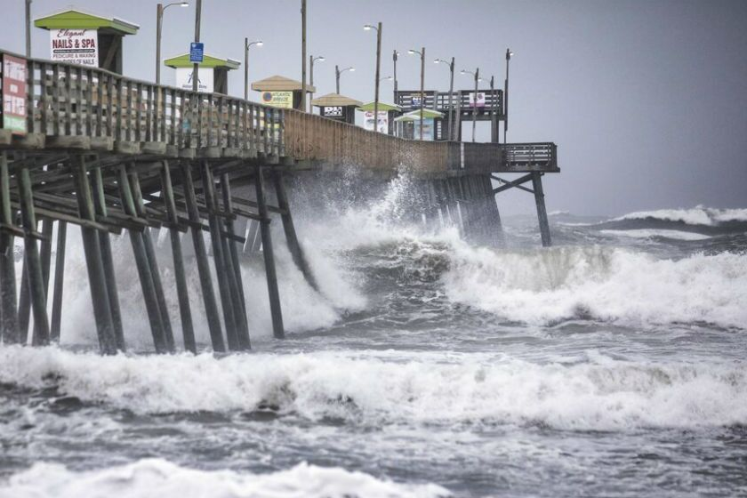 Waves pound the Bogue Inlet Fishing Pier in Emerald Isle, N.C., on Thursday.