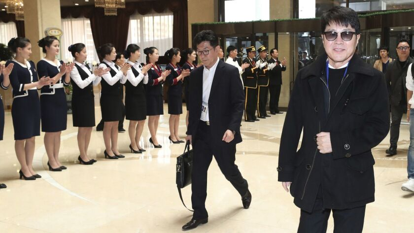 South Korean singer Cho Yong-pil, right, arrives at a hotel in Pyongyang, North Korea, on Saturday, He is one of many South Korean musicians, from aging crooners to bubbly K-Pop starlets, who flew to North Korea to perform.