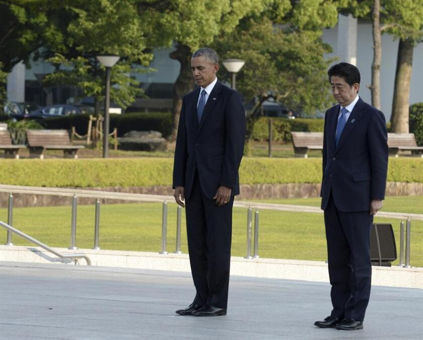 El presidente, Barack Obama, y el primer ministro de Japón, Shinzo Abe, completarán este martes con una visita a Pearl Harbor (Hawai) el mensaje de reconciliación que dieron en Hiroshima en mayo pasado. EFE/ARCHIVO