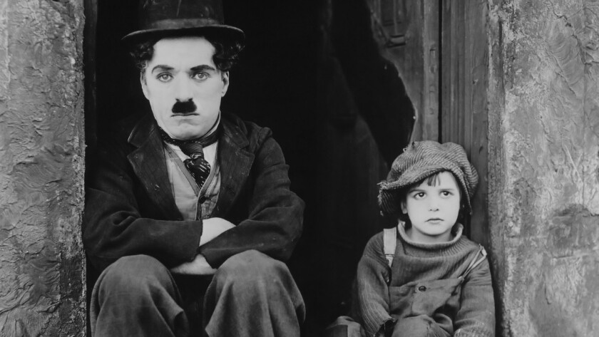 "Charlie Chaplin, left, and Jackie Coogan in the 1921 silent film ""The Kid."""