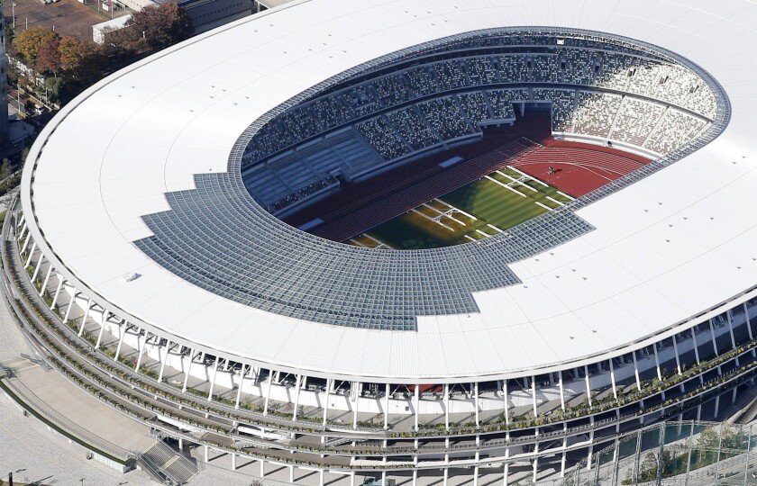 The new National Stadium, main stadium for the 2020 Tokyo Olympics and Paralympics, is seen after its completion in Tokyo Saturday, Nov. 30, 2019. (Kyodo News via AP)