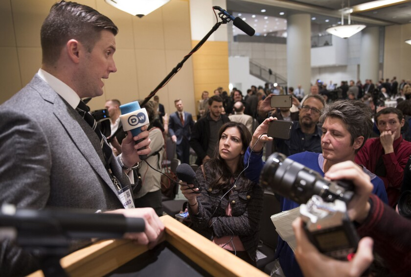 White nationalist leader Richard Spencer, left, at the National Policy Institute's conference in Washington D.C. on Nov. 18.
