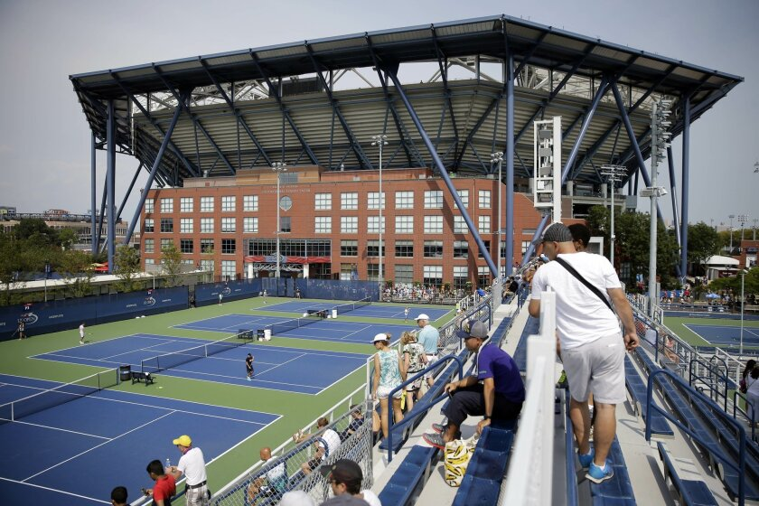 Fans view athletes practice ahead of the U.S. Open tennis tournament, Sunday, Aug. 30, 2015, at the USTA Billie Jean King National Tennis Center in New York. (AP Photo/Matt Rourke)