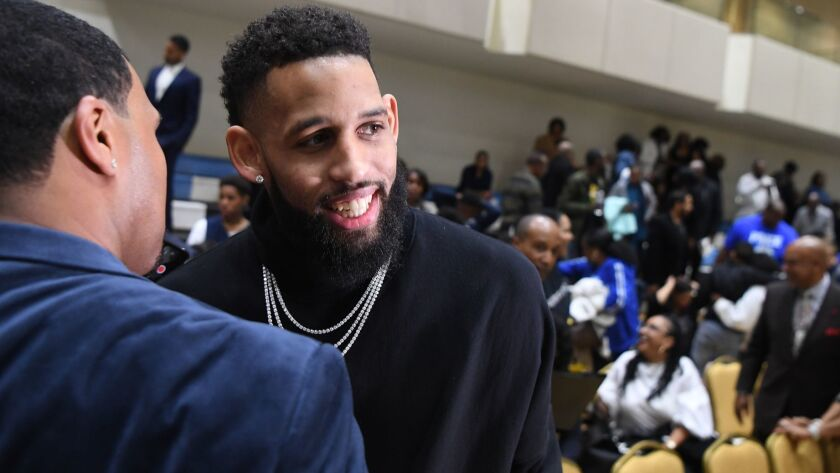 Allen Crabbe is greeted during a court-naming ceremony at Price Christian Schools, which is part of the Crenshaw Christian Center in Los Angeles.