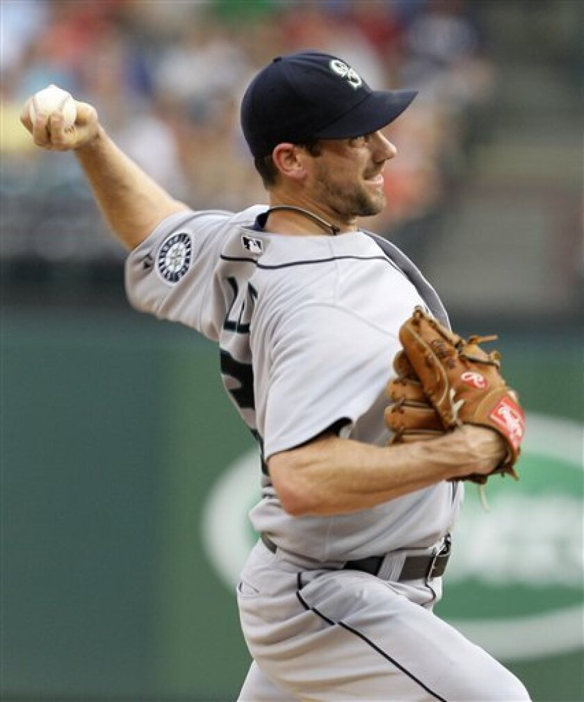 Seattle Mariners starting pitcher Cliff Lee delivers to the Texas Rangers in the first inning of a baseball game Monday, June 7, 2010, in Arlington, Texas. (AP Photo/Tony Gutierrez)