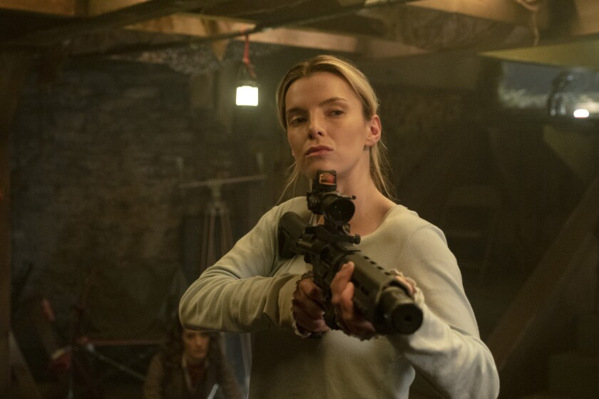 """This image released by Universal Pictures shows Betty Gilpin in a scene from """"The Hunt."""" (Patti Perret/Universal Pictures via AP)"""